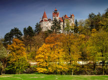 Bran Castle in autumn landscape Royalty Free Stock Image
