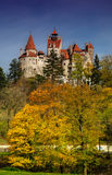 Bran Castle in autumn landscape Royalty Free Stock Photo