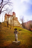 Bran Castle (Dracula castle) with cross tomb. Nearby in Transylvania and Wallachia, Romania Stock Photography