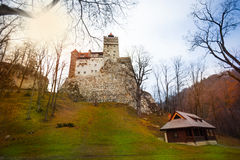 Bran Castle (Dracula castle) with house nearby. In Transylvania and Wallachia, Romania Royalty Free Stock Image