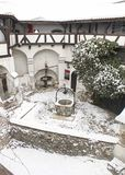 The Bran Castle -  fountain in the courtyard Stock Image