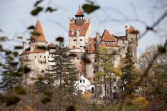 Bran castle among leaves Royalty Free Stock Photos