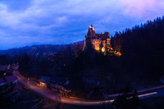 Bran Castle with lights at night in Romania Royalty Free Stock Images