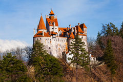 Bran Castle among trees on hill in Romania Royalty Free Stock Images