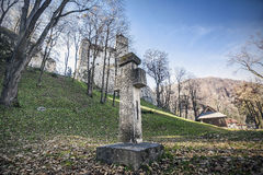 Bran castle entrance. Stone cross in front of Bran Castle, Romania Stock Photos