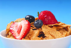 Bran cereal with blueberries, strawberries Stock Photos