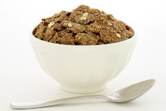 Bran cereal breakfast with oats. Delicious and nutritious bran flakes cereal, high in bran, high in fiber, served in a beautiful  French Cafe au Lait Bowl with Royalty Free Stock Photos
