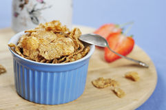 Bran flakes cereal in blue bowl Royalty Free Stock Image