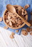 Bran flakes in a wooden bowl closeup. vertical top view Stock Images