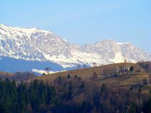 Bran - Moeciu, with the Bucegi mountains in the backdrop, in Romania. Bran - Moeciu with the Bucegi mountains in the backdrop, in Romania. winter mountains royalty free stock image