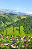 Bran Moeciu village  Romania Bucegi  mountains. Bran Moeciu village  Romania with Bucegi montains landscape Royalty Free Stock Images