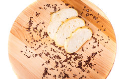 Bran muffin, black beans on a wooden tray. Bran muffin, black beans, with a knife on a wooden tray Stock Photos