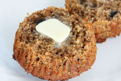 Bran muffin with butter Royalty Free Stock Image