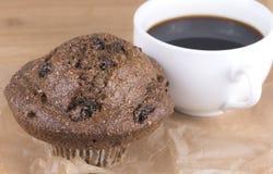 Bran muffin. Fresh baked bran and raisin muffin with coffee Stock Photo