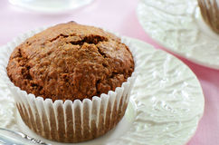 Bran muffin on pretty plate Stock Photography