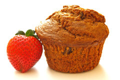 Bran Muffin with Strawberry Stock Images