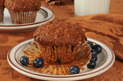 Bran muffin with wild blueberries Stock Photos