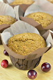 Bran muffins. Close-up of freshly baked bran and cranberry muffins on a wooden tray Stock Photos