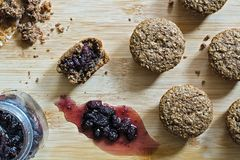Bran muffins with Mulberry jam top view. Bran Muffins with home made Mulberry jam on a wooden surface. Top view Royalty Free Stock Photo