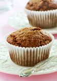 Bran muffins on pretty plates. Bran muffins on cream colored rippled plates in vertical format Stock Photos