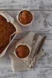 Bran muffins with raisins and a cup of coffee Stock Photos