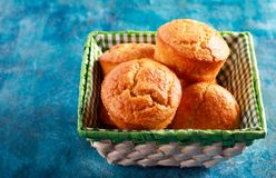Bran muffins in small wicker. Bread basket Stock Images