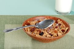 Bran and raisin cereal with spoon Stock Photography