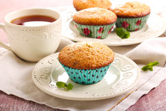 Bran and raisin muffins. And cup of tea Stock Photos
