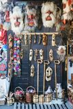 Various handmade scary masks on the souvenir market at castle. Bran, Romania - October 5, 2018: Various handmade scary masks on the souvenir market at castle stock images