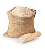 Bran in sack and wooden scoop royalty free stock images
