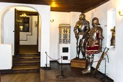 Interior rooms of the medieval Bran Castle in Romania. Antique Knight Armor at Dracula`s Castle stock photography