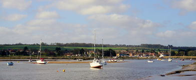 Brancaster Staithe summer. Brancaster harbour looking back towards the village Stock Image