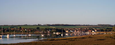 Brancaster Staithe summer. Brancaster harbour looking back towards the village Stock Images