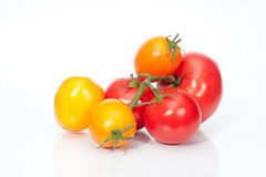 The branch of cherry tomatoes. On white Royalty Free Stock Photos