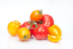 The branch of cherry tomatoes. On white Stock Image