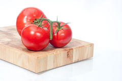 The branch of cherry tomatoes. On bred Stock Image