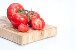 The branch of cherry tomatoes. On bred Royalty Free Stock Image