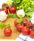 The branch of cherry tomatoes, onions Stock Images