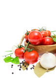 The branch of cherry tomatoes in a wooden bowl Stock Photos