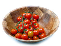 branch of cherry tomatoes in a wooden bowl Stock Photography