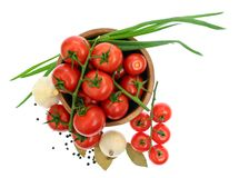 The branch of cherry tomatoes in a wooden bowl, i  Stock Image