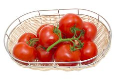 The branch of cherry tomatoes in a wooden bowl, Royalty Free Stock Images