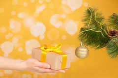 Branch of Christmas fir-tree with ornament and Stock Photos