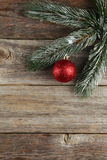 Branch of Christmas tree with balls on grey wooden background Royalty Free Stock Photos