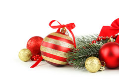 Branch of Christmas tree with balls isolated on white background Stock Images
