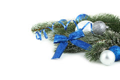 Branch of Christmas tree with balls isolated on white background Royalty Free Stock Photos
