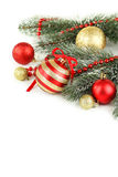 Branch of Christmas tree with balls isolated on white background Stock Photos
