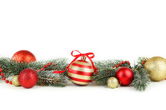 Branch of Christmas tree with balls isolated on white background Royalty Free Stock Photography