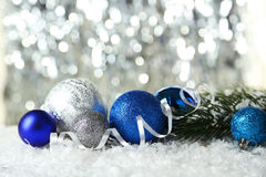 Branch of Christmas tree with balls on the snow Stock Image