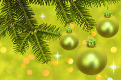 Branch of christmas tree with baubles stock photo